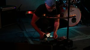 Joey Landreth putting Origin Effects RevivalDRIVE on pedalboard